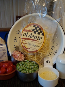 ingredients for al dente pasta with peas, pancetta, parm and tomatoes
