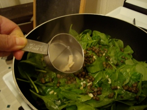 add hot water to spinach mixture