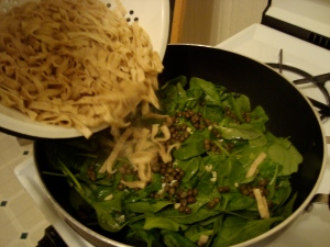 add drained pasta to spinach mixture
