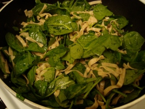 toss pasta and spinach until heated through